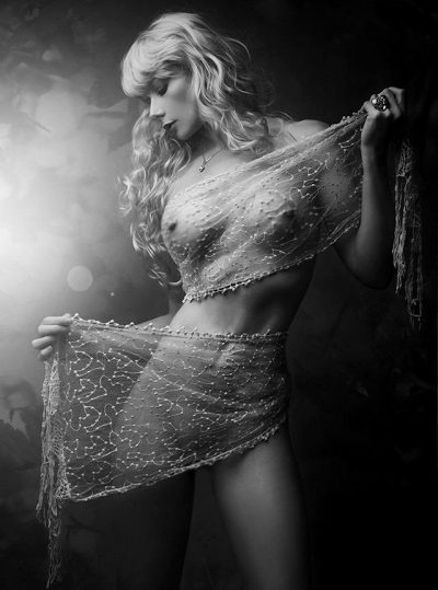 Black And White Photo Of A Slender Blonde Model In A Single Transparent Veil.
