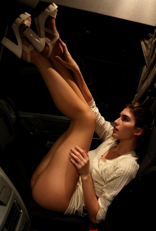 just-under-60-model-in-the-front-seat-of-a-tractor-trailer_001